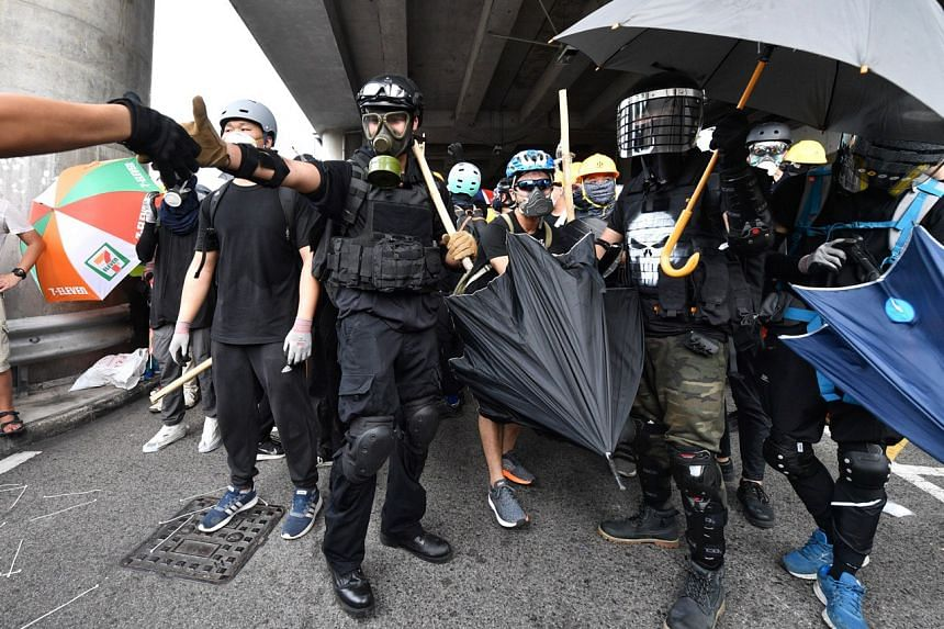Armed and well-protected protesters preparing to confront riot police officers during a mass rally in Yuen Long on July 27, 2019.