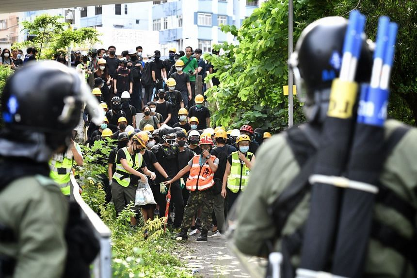 Protesters facing off against police officers at Yuen Long, on July 27, 2019.