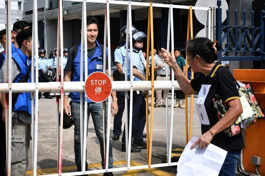 A protester berating police officers during a mass rally in Yuen Long on July 27, 2019.