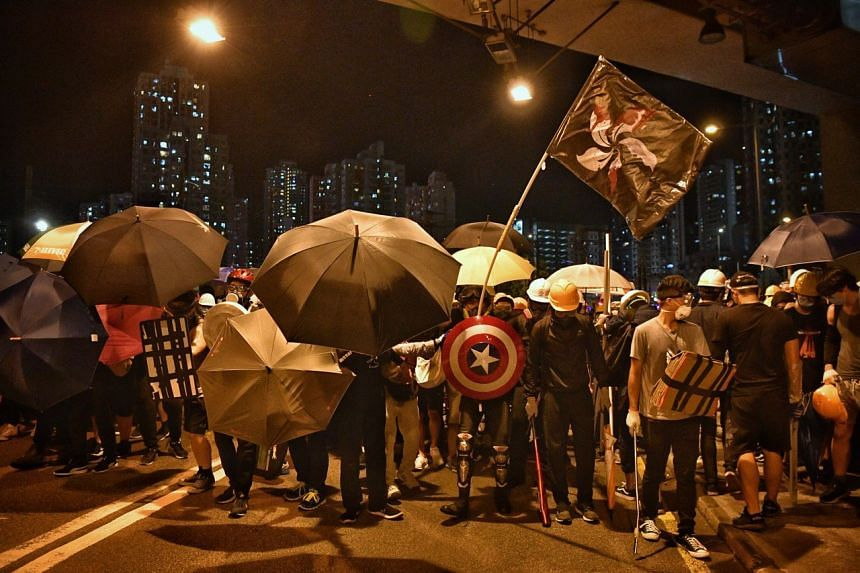 Protesters gathering at Yuen Long MTR station as they prepare to face off against police officers, on July 27, 2019.