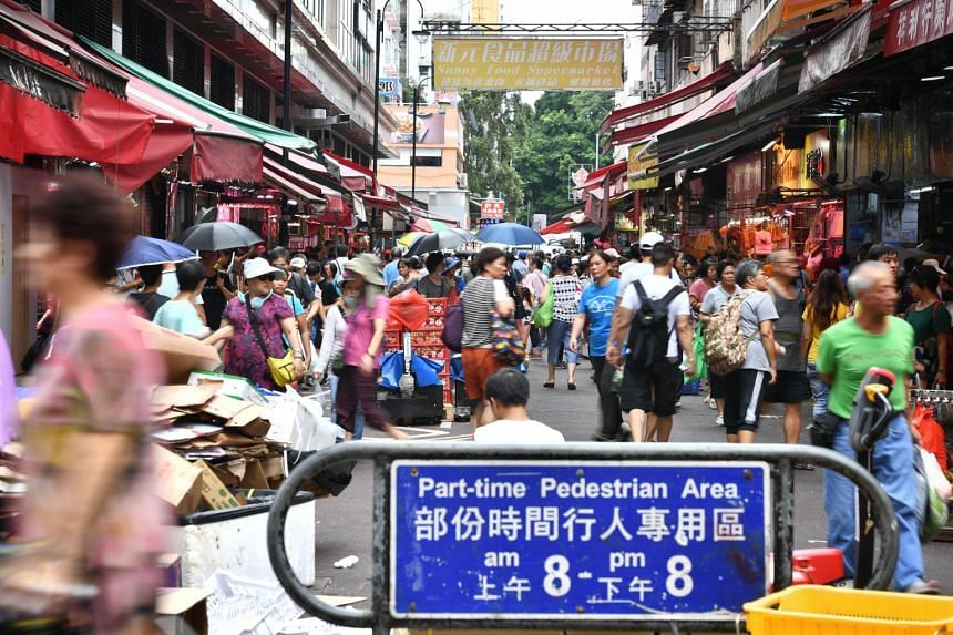 The town centre was bustling with residents on their grocery runs in the main market.