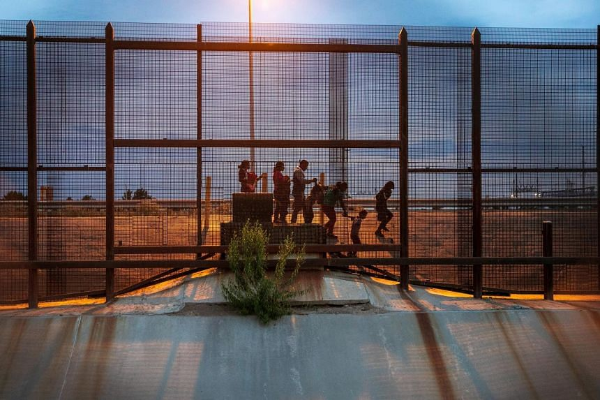 A group of migrants from Guatemala walking along the Mexican side of the border wall, near El Paso, Texas, last month looking for an opportunity to seek asylum in the United States. Under the new asylum deal, says the White House, Guatemala would be