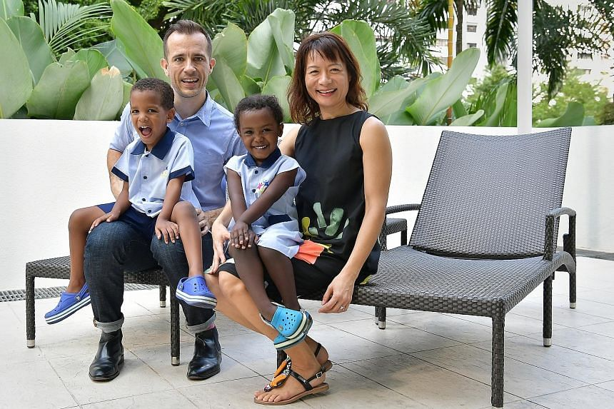 Spoka's Mr David Grainger with his wife Kirsty Leong, who is global policy officer of World Wildlife Fund for Nature, and their two children adopted from Ethiopia, Remi (left), four, and Wegeny, three. Money, to Mr Grainger, means options and a sprin