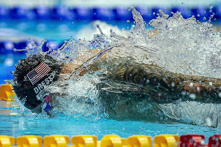 Caeleb Dressel on his way to winning the 100m butterfly final at the Fina World Championships in Gwangju, South Korea, yesterday. He clocked a time of 49.66sec, after setting a world-record time of 49.50sec in Friday's semis.