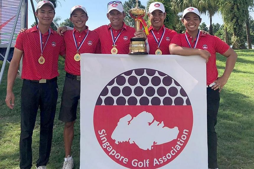 Singapore's victorious Putra Cup team (from left) Donovan Lee, Justin Kuk, national coach Matt Ballard, Low Wee Jin and Nicklaus Chiam. The success is a confidence-booster for the SEA Games in the Philippines at the end of the year.