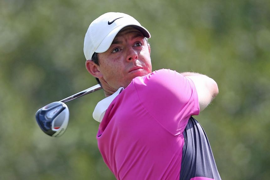 McIlroy watches his tee shot on the 18th hole during the third round.