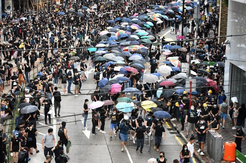 Protesters were seen removing metal railings in Causeway Bay to set up barricades.