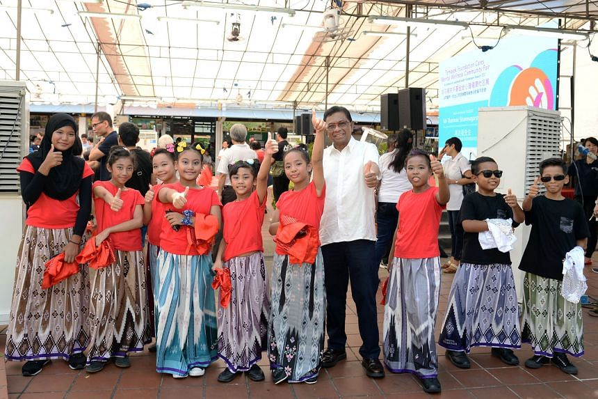 Mr Magnus with child performers during a community mental wellness fair organised by Temasek Foundation in 2017.