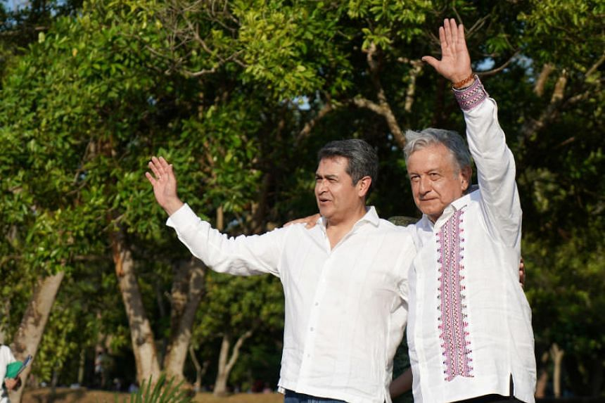 Honduran President Juan Orlando Hernandez (left) and Mexican President Andres Manuel Lopez Obrador (right) pledged to work together to lift prosperity in Central America.