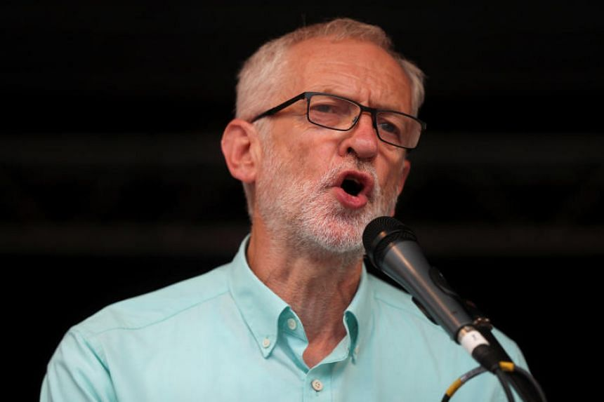 """Asked about the prospect of pushing for a no-confidence vote in the government, Britain's opposition Labour Party leader Jeremy Corbyn said he would """"look at the situation"""" when Parliament returns from its summer break in September."""