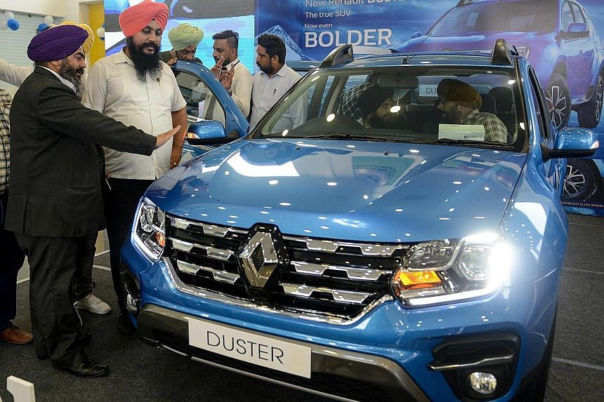 Visitors at a car launch in Amritsar, India. The sale of passenger vehicles in India declined by 18.42 per cent in the April-to-June quarter this year, compared with the same period last year. It was the sharpest decline since a 23.1 per cent drop in