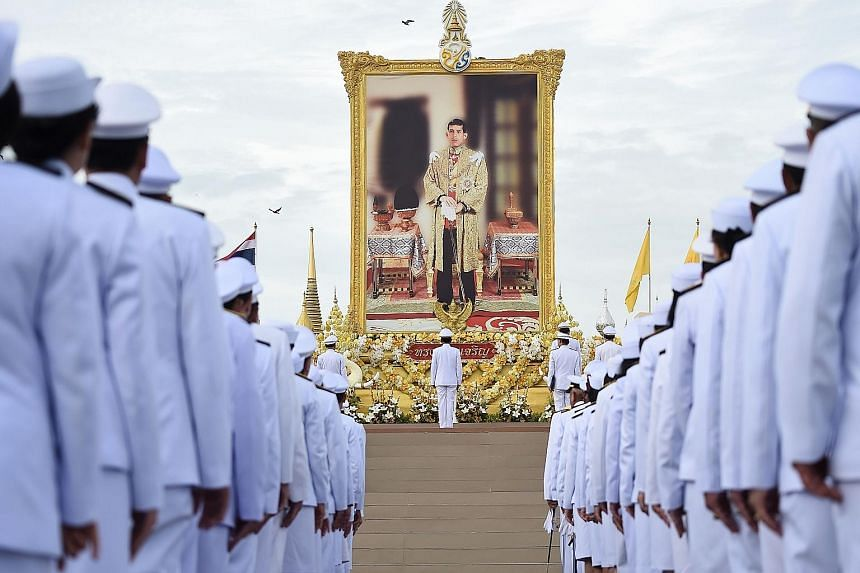Thai Prime Minister Prayut Chan-o-cha (centre) and officials paying their respects before a portrait of King Maha Vajiralongkorn during celebrations for his 67th birthday in Bangkok yesterday. It was the first birthday celebration of the monarch sinc