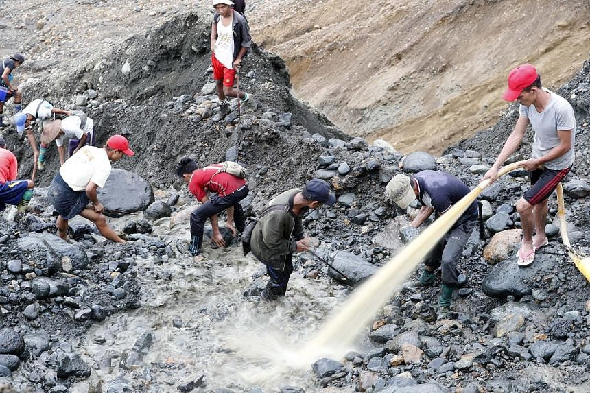 Miners searching for jade in Hpakant earlier this month. Yesterday's landslide is the latest to hit the Myanmar township, the epicentre of a lucrative jade trade fuelled by demand in China.