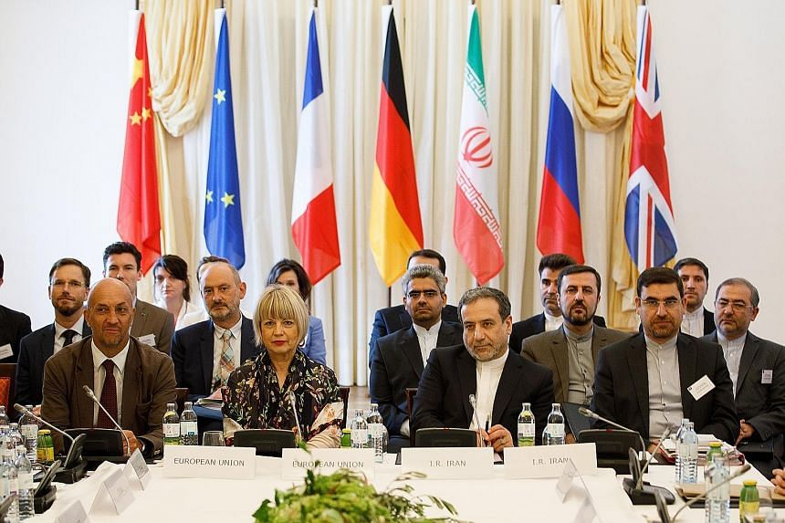 """EU director Helga Schmid and Iranian Deputy Foreign Minister Abbas Araqchi (third from left) at yesterday's emergency meeting in Vienna, Austria, of parties to the 2015 nuclear deal. Mr Araqchi said that while the atmosphere was """"constructive"""", there"""