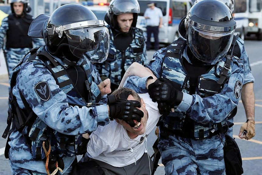 Law enforcement officers arresting on Saturday a participant of a rally calling for opposition candidates to be registered for elections to Moscow City Duma, the capital's regional parliament, in Moscow.