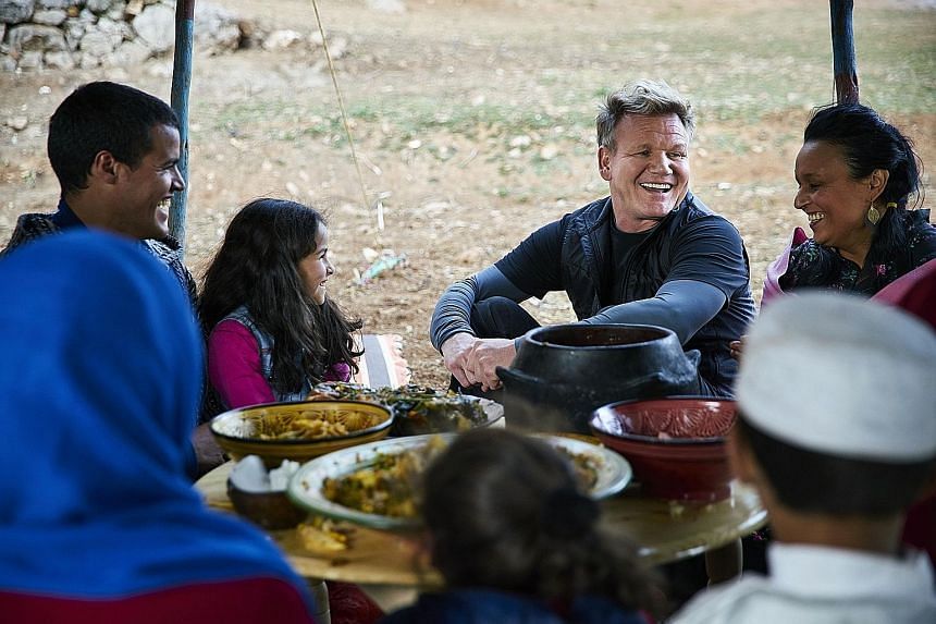Gordon Ramsay and Moroccan chef Najat Kaanache celebrate with locals during a feast for the Berber New Year.