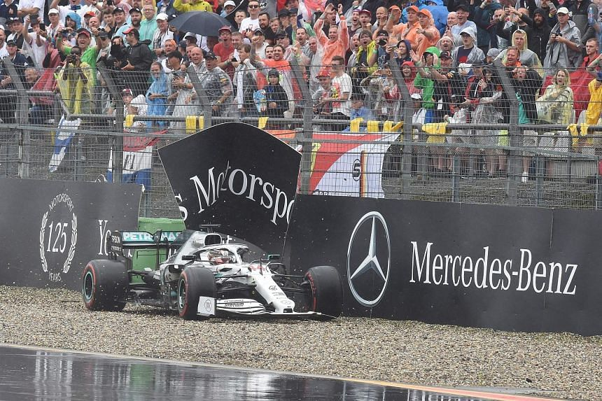 Lewis Hamilton's Mercedes hits the wall and he finishes 11th. Teammate Valtteri Bottas crashed out with six laps remaining.