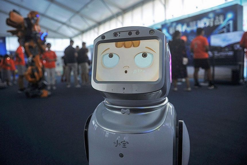 A robot at an exhibition in Qingdao, China. Artificial intelligence refers to computer-controlled robots or systems which can perform the tasks that a human can. It tries to simulate intelligent behaviour and human traits such as decision-making, and