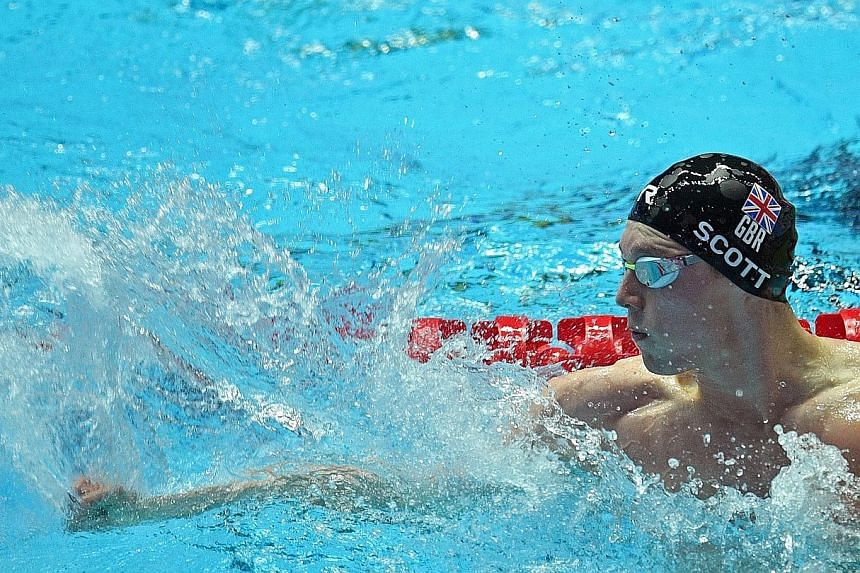 Duncan Scott punching the water to celebrate after anchoring Britain to the gold medal, ahead of the US, in the men's 4x100m medley relay on the final day of the World Championships in Gwangju, South Korea.