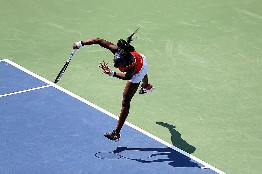 Coco Gauff serving to Maegan Manasse during qualifying for the Citi Open at Rock Creek Tennis Centre on Saturday in Washington. The teen sensation drew a crowd of 3,000.