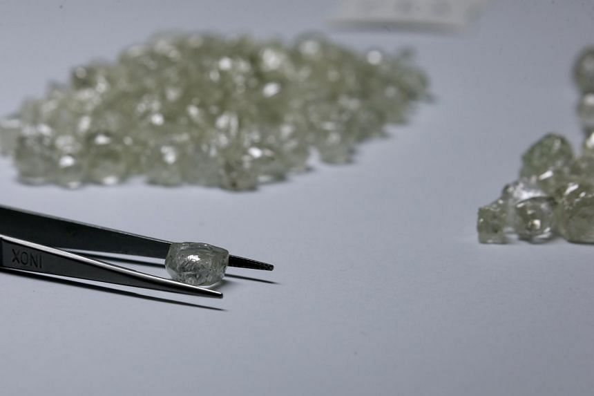 """De Beers sells its gems through 10 sales each year in Botswana's capital of Gaborone, and the buyers - known as """"sightholders"""" - have to accept the price and the quantities they're offered."""