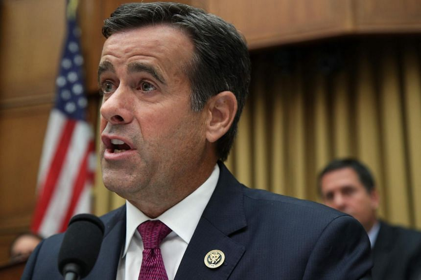 """President Donald Trump on Sunday tweeted that Mr John Ratcliffe (pictured) """"will lead and inspire greatness for the country he loves"""" as the next director for national intelligence."""