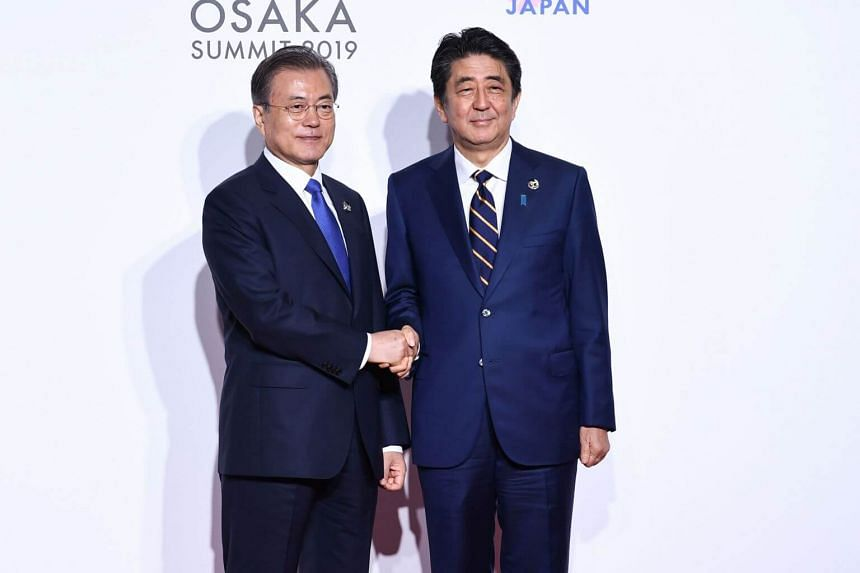 Japan Prime Minister Shinzo Abe (right) will not hold talks with South Korean President Moon Jae-in unless Seoul takes constructive steps on the issue of World War II labourers and other issues, Sankei newspaper reported on July 29, 2019.