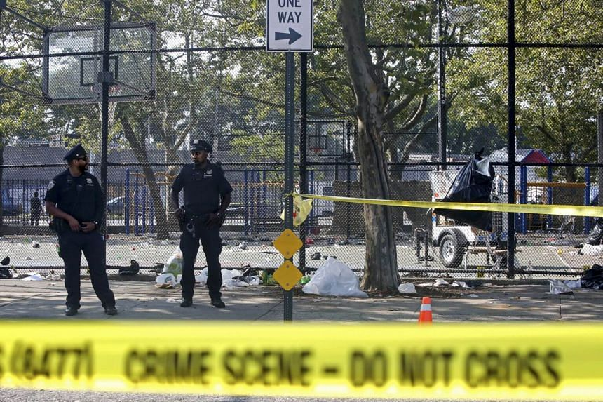 Police officers at the scene of a shooting near the Brownsville Recreation Centre in Brooklyn on July 28, 2019.