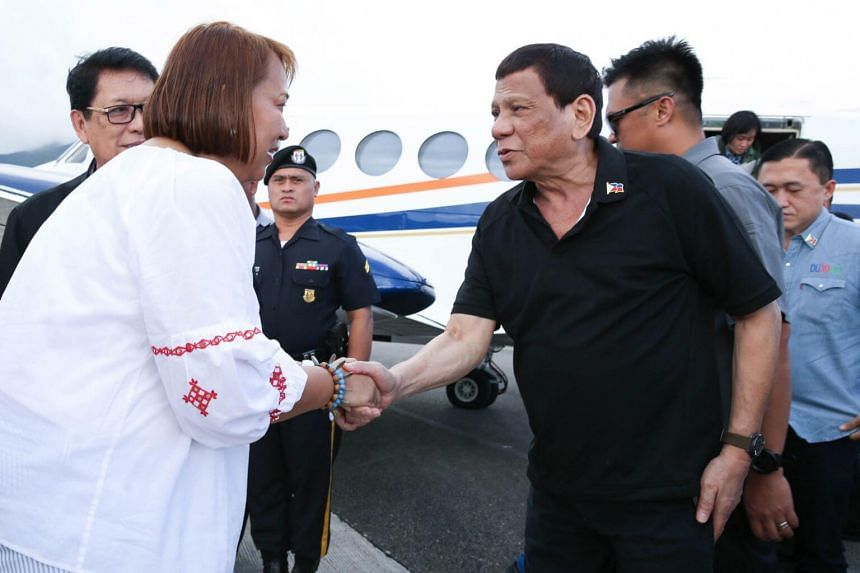 Philippine President Rodrigo Duterte being welcomed by Batanes Governor Malou Cayco (left), upon his arrival at an airport following an aerial inspection of the earthquake-hit town of Itbayat, Philippines, on July 28, 2019.