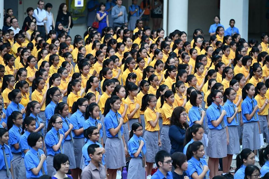 Students from Cedar Girls' Secondary School reciting the pledge during morning assembly on Jan 3, 2017.