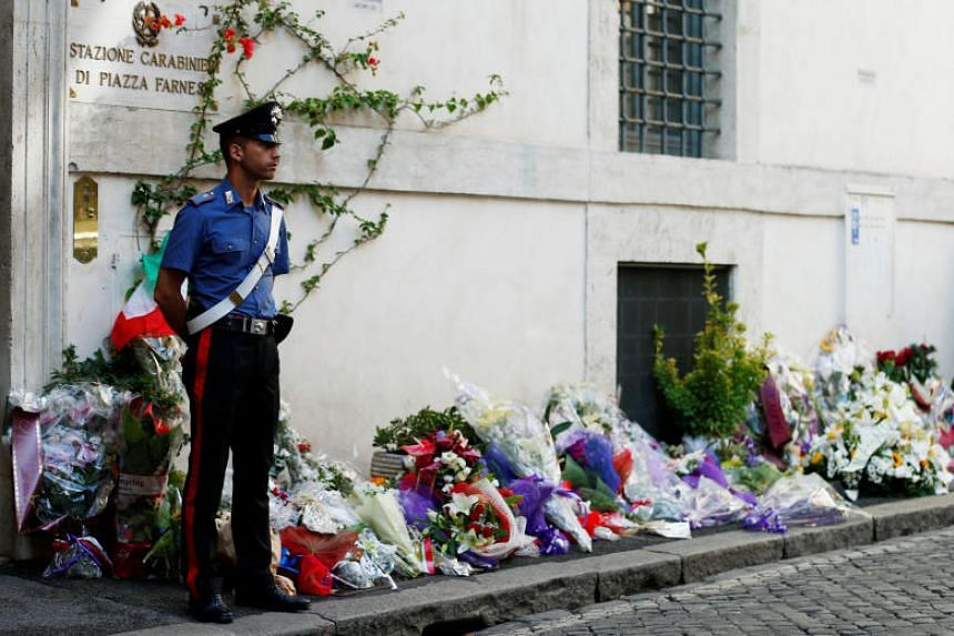 Flowers are seen in front of the Carabinieri station where Deputy Brigadier Mario Cerciello Rega was stationed, in Rome, Italy, on July 28, 2019.