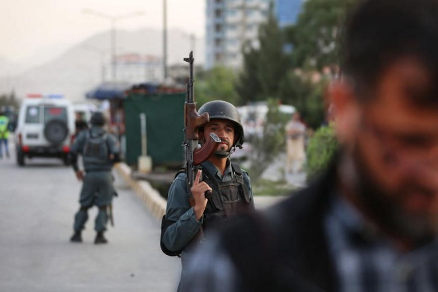 Afghan security forces cordon the area after multiple explosions targeted a political gathering where vice-presidential candidate Amrullah Saleh was also present in Kabul, Afghanistan, on July 28, 2019.