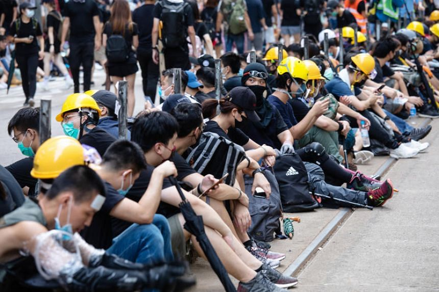 Demonstrators gather in the Causeway Bay district of Hong Kong on July 28, 2019. Hong Kong stocks were poised for their worst drop in six weeks on July 29 on concern the city's prolonged protests will take a toll on the local economy.