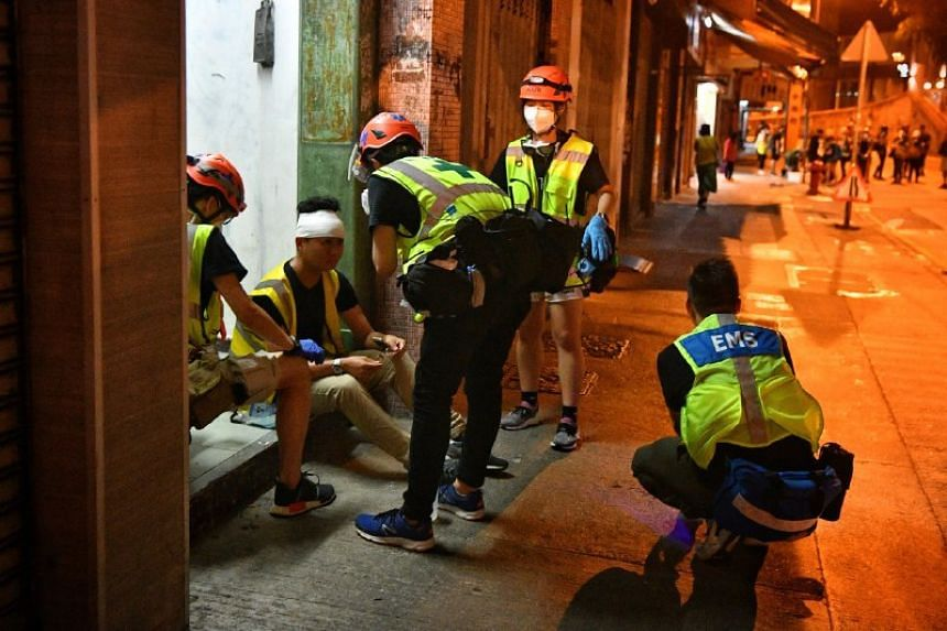 Volunteer medics attending to a man in Sheung Wan in Hong Kong on July 28, 2019.