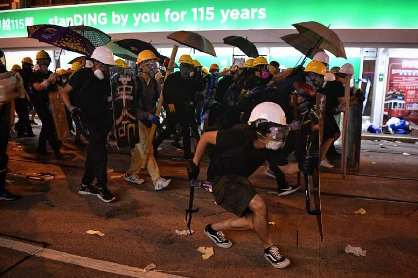 Protesters advancing slowly in Sheung Wan in Hong Kong on July 28, 2019.