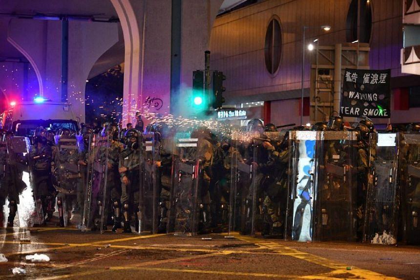Hong Kong police fire tear gas in Sheung Wan on July 28, 2019.