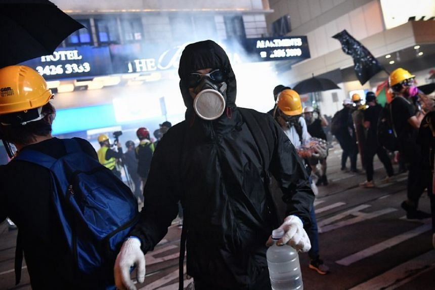 A protester with saline for those affected by the tear gas fired by Hong Kong police on July 28, 2019.