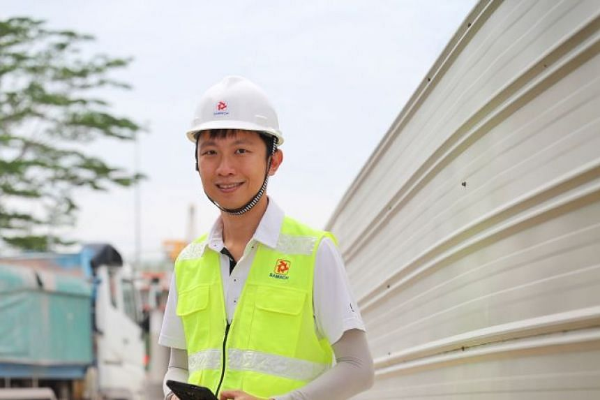 Mr Scott Ho has to deal with problems at the work site in his role as a project manager at construction firm Samwoh. He is currently leading a team of more than 30 people in building a flyover at one-north.