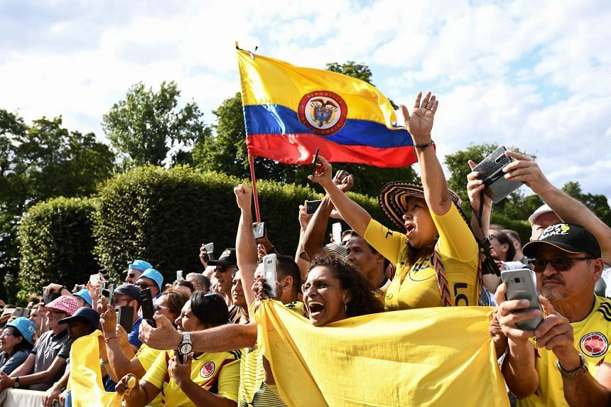Colombian fans cheering for Tour de France leader Egan Bernal during the final stage from Rambouillet to the Champs-Elysees in Paris yesterday.