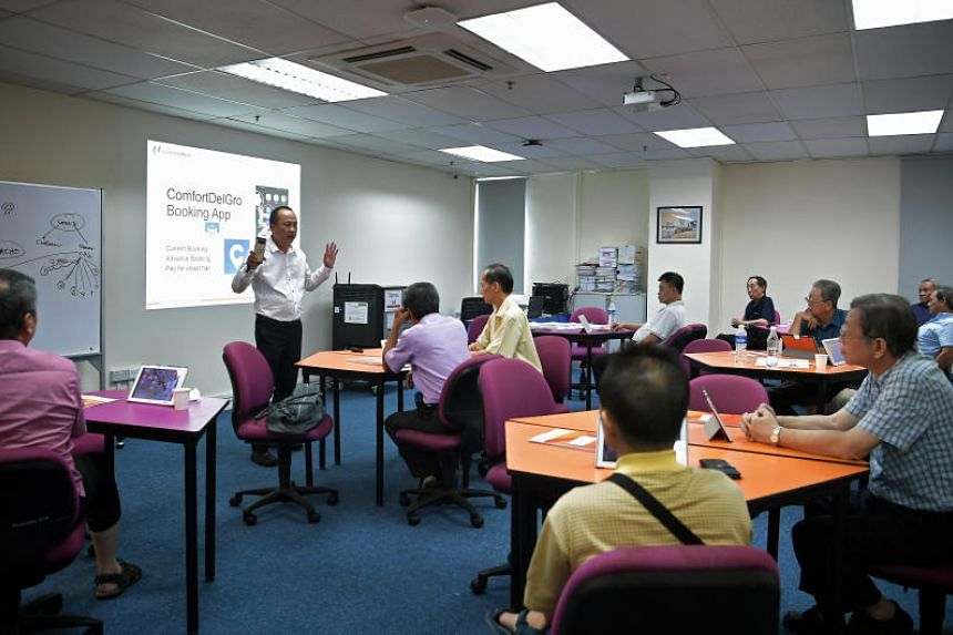 Taxi drivers attending the SkillsFuture for Digital Workplace Class at ComfortDelGro Taxi's CityCab building in Sin Ming Avenue on July 29, 2019.