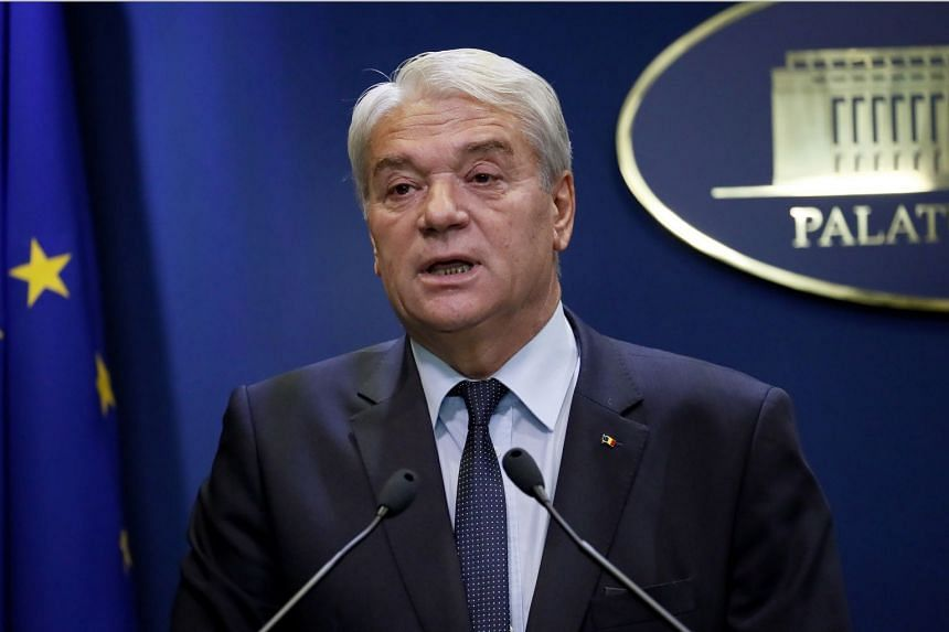 Romanian Interior Minister Nicolae Moga, 66, announces his resignation.