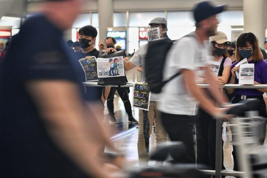 Protesters gathered at Hong Kong's busy airport  with the goal of spreading their message to foreigners visiting the city.