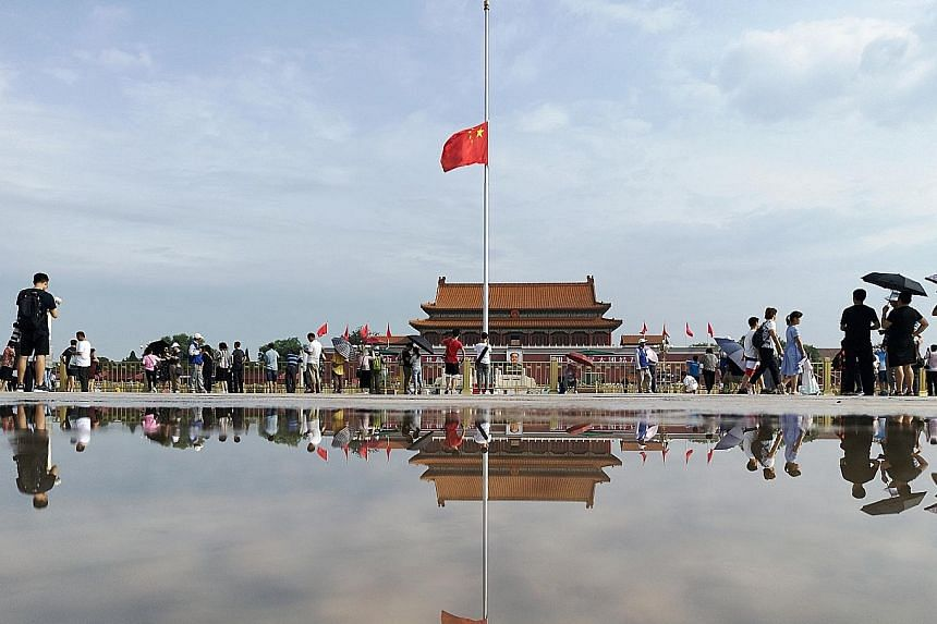 China's national flag flying at half-mast at Tiananmen Square in Beijing yesterday, as a mark of respect to the late former premier Li Peng. PHOTO: REUTERS