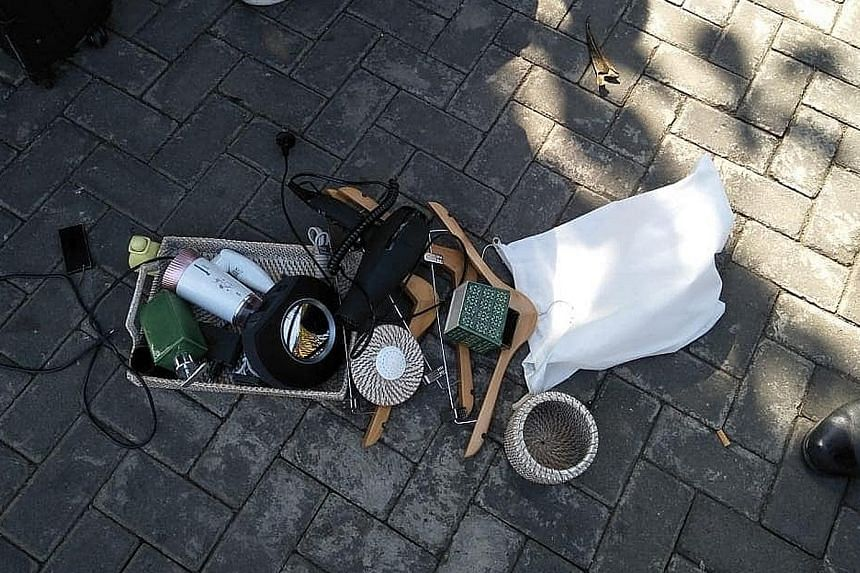 Some of the items recovered from the family's luggage by hotel staff included a bottle of liquid soap, towels, a mirror and a hairdryer. PHOTO: POLSEK SUKAWATI/ FACEBOOK