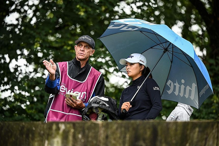 Veteran caddie Dave Brooker discussing a shot with South Korean Ko Jin-young in the final round of the Evian Championship in the French Alps town of Evian-les-Bains.