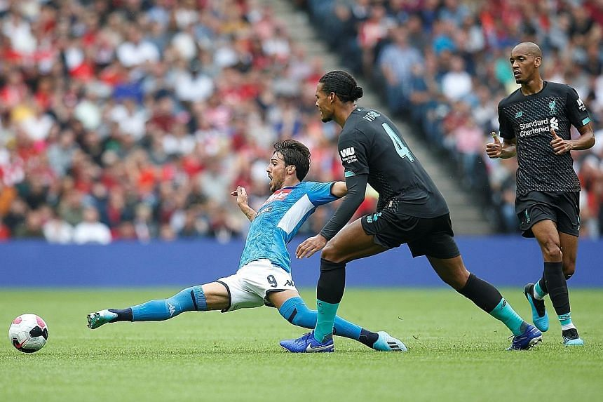 Napoli's Simone Verdi stretching for the ball during his team's 3-0 win over Liverpool in a friendly at Murrayfield Stadium in Edinburgh on Sunday. The result meant the Reds are winless in their last four pre-season games.