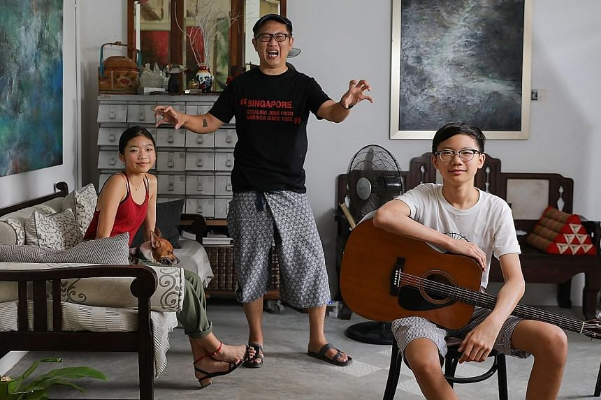 """Mr Calvin Soh (centre), an adman turned farmer and product innovator, encourages his children Ava (left) and Dylan to take on projects outside school as he wants them to be creative individuals because """"creativity is the new superpower"""", he says. ST"""