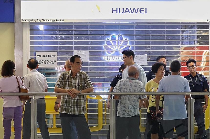 Some members of the public seen outside the Huawei store at Nex shopping mall in Serangoon on Friday. Many consumers who queued up for the Huawei Y6 Pro were disappointed and angry. Huawei has apologised for the insufficient supply, saying it had rec
