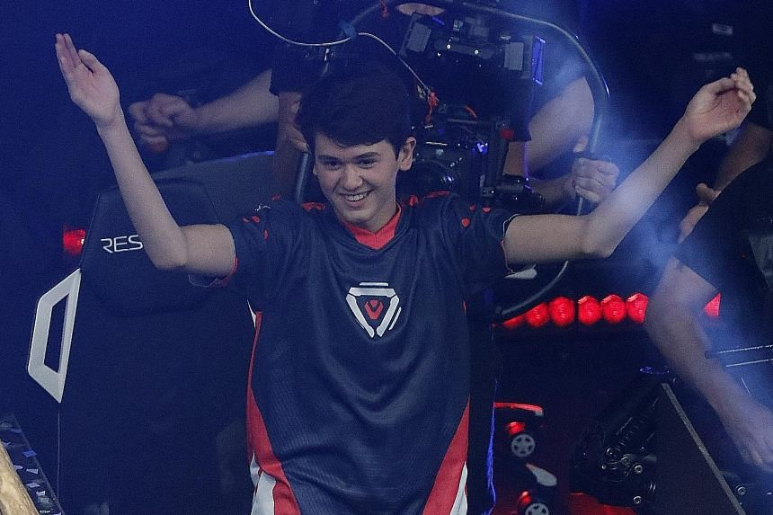 """Pennsylvania teenager Kyle """"Bugha"""" Giersdorf celebrating after winning the finals of the solo competition on Sunday. PHOTO: EPA-EFE A screen showing the players during the final of the solo competition at the Fortnite World Cup Finals on Sunday in Ne"""