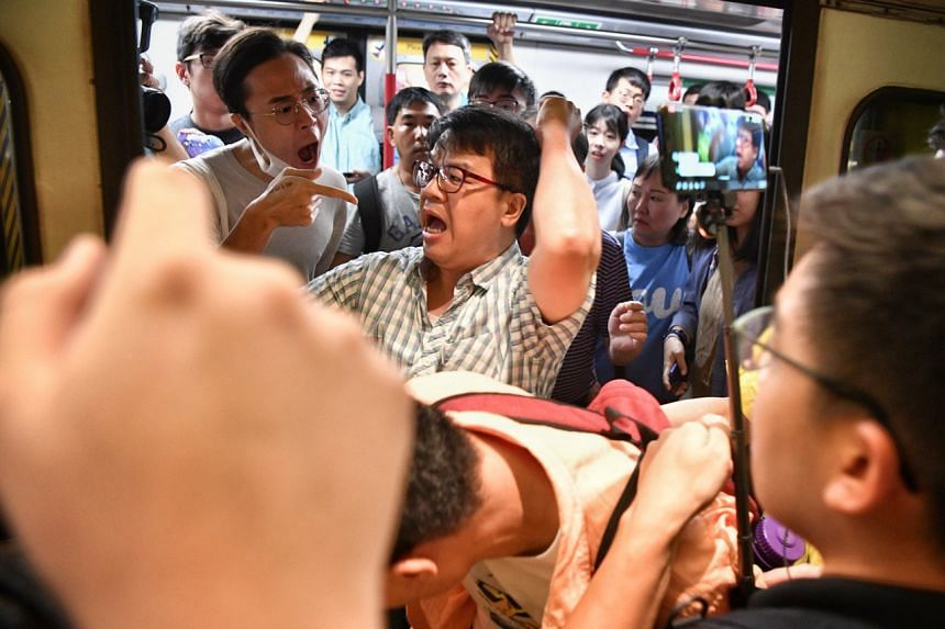 In one train carriage, some commuters got into heated arguments with the protesters and the police had to step in.